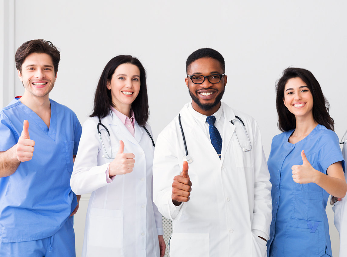 group of doctors giving thumbs up