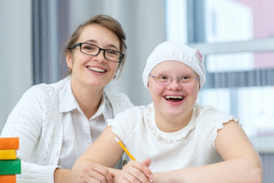 caregiver with a little girl with autism