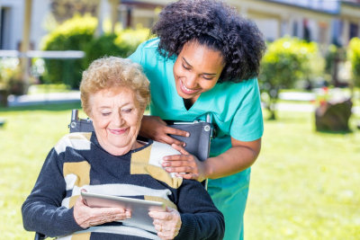 elder woman with caregiver outdoors