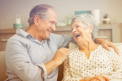 elderly couple laughing at each other