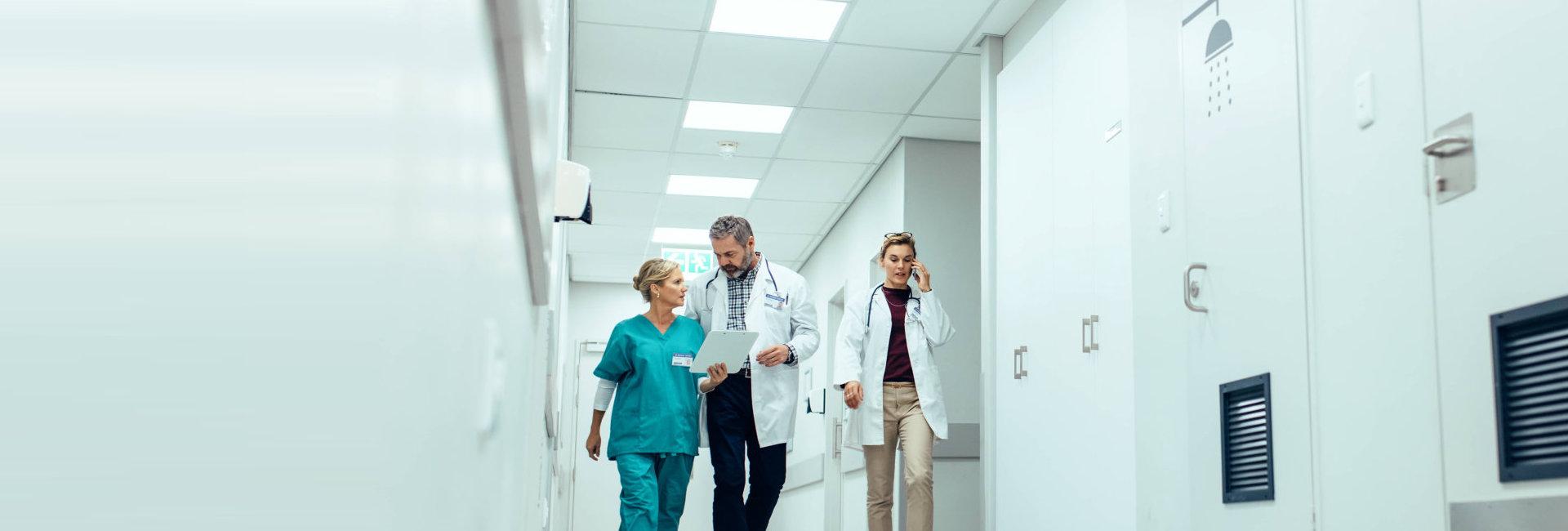 nurse talking to doctor